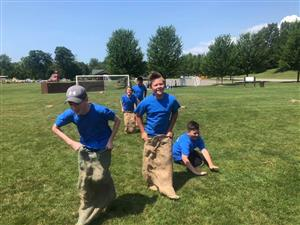 Camp Compete Day potato sack race!